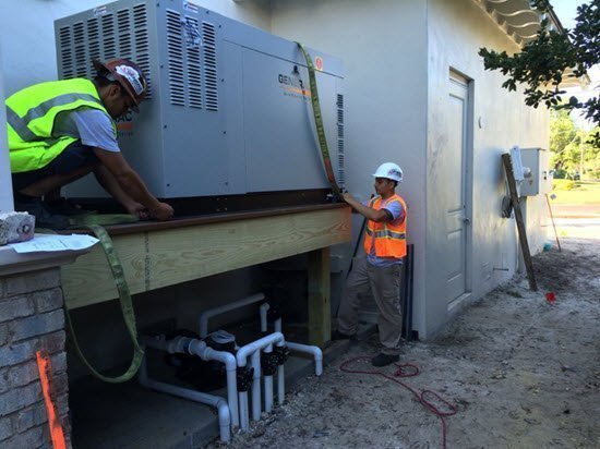 Contractors Installing a generator on a raised platform above flood level